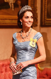 Kate Middleton paired a gemstone-inlaid clutch with an ice-blue dress for a State Banquet at Buckingham Palace.