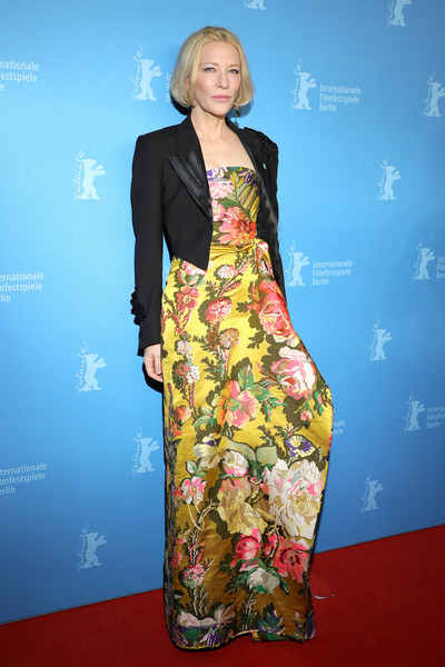 Cate Blanchett topped off her dress with a black cropped jacket.