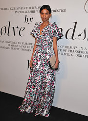 Liya Kebede paired her busy-looking dress with a simple nude snakeskin clutch.