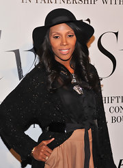 June Ambrose wore a classic black hat at 'The Ever Changing Face of Beauty' party.