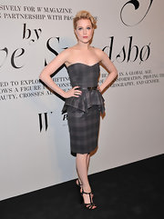 Evan Rachel Wood looked striking in this gray plaid peplum dress at the Ever Changing Face of Beauty reception.