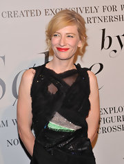 Cate Blanchett wore her hair in a bobby-pinned updo with side-swept bangs at The Ever Changing Face of Beauty party.