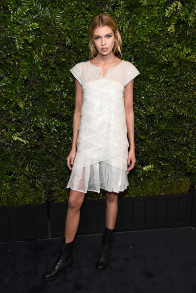 Stella Maxwell Combat Boots [clothing,white,dress,fashion,fashion model,shoulder,cocktail dress,footwear,joint,blond,charles finch,stella maxwell,chanel pre-oscar awards,dinner,beverly hills,california,madeo,madeo in beverly hills,chanel]