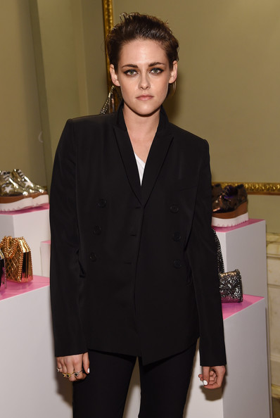 Kristen Stewart attended the Stella McCartney Autumn 2015 presentation wearing several gemstone rings by Brooke Persich.