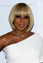 Mary J. Blige showed off a super-neat bob with blunt bangs at the Stella McCartney presentation.