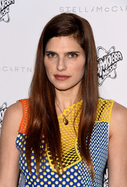 Lake Bell wore her long hair loose with a side part at the Stella McCartney presentation.