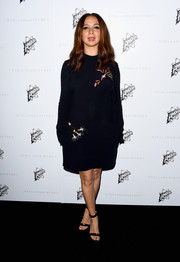 Maya Rudolph wore a classic black dress with embellished designs that she styled with strappy heels.