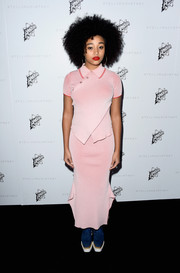 Amandla Stenberg added color with her pastel pink fitted dress, bright red lip, and blue runners.