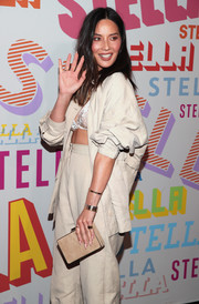 Olivia Munn went for a monochromatic look with this beige box clutch and pantsuit combo at the Stella McCartney Autumn 2018 collection launch.