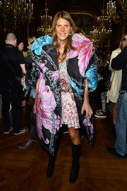 Anna dello Russo added edge to her girly look with a pair of black lace-up boots.