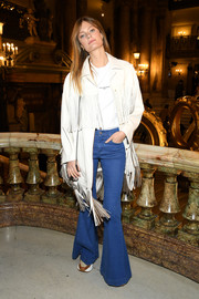 Constance Jablonski amped up the '70s feel with a pair of flare jeans.