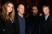 (L-R) Cara Delevingne, Woody Harrelson, Kanye West and Paul McCartney attend the Stella McCartney show as part of the Paris Fashion Week Womenswear Fall/Winter 2015/2016 on March 9, 2015 in Paris, France.