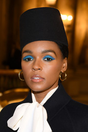 Janelle Monae finished off her look with classic gold hoop earrings.