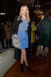 Lily Donaldson capped off her look with a black suede coat.