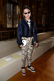Mademoiselle Yulia paired her jacket with funky animal-print pants.
