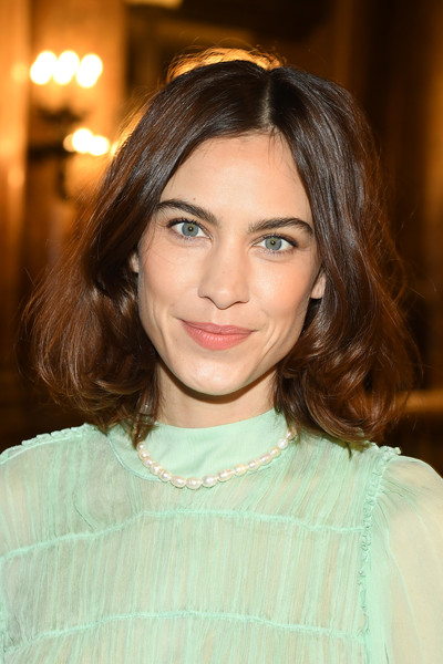 Alexa Chung went for ladylike styling with a strand of pearls.