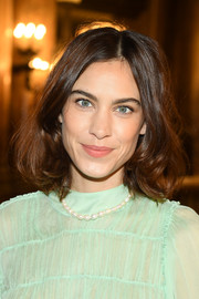 Alexa Chung wore her hair in a bouncy lob at the Stella McCartney Fall 2019 show.