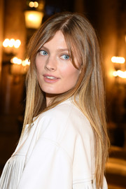 Constance Jablonski sported a long straight hairstyle with parted bangs at the Stella McCartney Fall 2019 show.