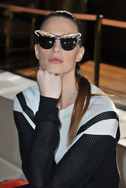 Elettra Wiedemann accessorized with a pair of costume-y cateye sunglasses when she attended the Stella McCartney fashion show.