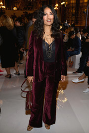 Salma Hayek donned a wine-colored velvet pantsuit by Stella McCartney for the brand's Spring 2018 show.