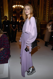 Natalia Vodianova kept it comfy all the way down to her silver Stella McCartney Elyse brogues.