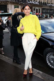 Miroslava cozied up in a bright yellow cable-knit sweater during the Stella McCartney fashion show.