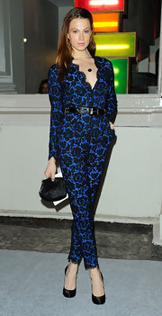 Elettra Wiedemann complemented her lace jumpsuit with a black frame clutch for an elegant finish at the Stella McCartney Soho store opening.