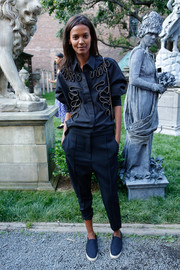 Liya Kebede attended the Stella McCartney presentation wearing a metal-embellished navy button-down from the label.