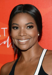 Gabrielle Union kept it classic with this center-parted chignon at the Inspiration Awards.
