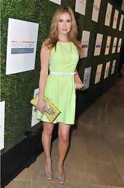Ashley Jones opted for a totally preppy look when she chose this sleeveless sheath dress in a light green hue.
