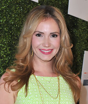 Ashley kept her beauty look fresh and feminine with a bold pink lip.