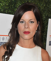 A big and bold red lip totally stood out against Marcia Gay Harden's crisp white dress.