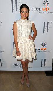 Nikki Reed teamed her feminine dotted dress with pointy mushroom suede pumps.