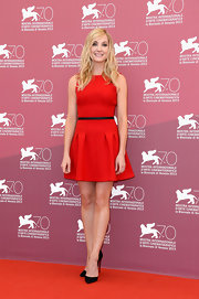 Joanne accented her waist with a red fit-and-flare mini dress.