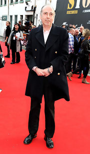 Mick Jones chose a classic pea coat for his red carpet look at 'The Stone Roses' premiere in Manchester.