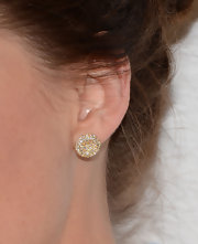 Clare Grant chose a pair of gold and diamond studs for her simple but elegant red carpet look.