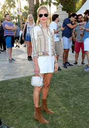 Kate Bosworth cut a stylish figure in a mixed-material Etro cropped jacket layered over an LWD during day 2 of Coachella.