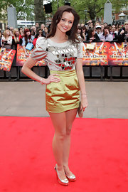 "Sianad Gregory showed off her heavily embellished dress while attending the premiere of ""StreetDance 3D""."