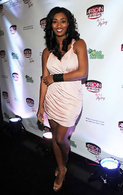 Toccara wears a soft pink ruched cocktail dress to show off her curves at the African Price event in Georgia.