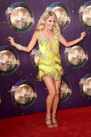 Mollie King shimmied on the red carpet wearing a fringed yellow mini dress at the 'Strictly Come Dancing 2017' launch.