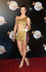 Victoria Pendleton looked all set for a dazzling performance in her strappy gold dancing shoes.