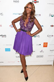Iman wore this purple cocktail dress with a lace-up bodice to the Fsahion Mom show.