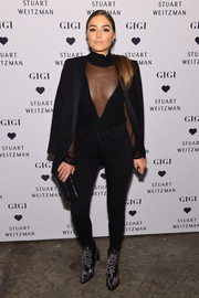 Olivia Culpo completed her dark look with black skinny jeans by J Brand.