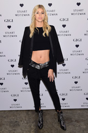 Devon Windsor pulled her outfit together with a pair of gunmetal Stuart Weitzman Gigi boots.