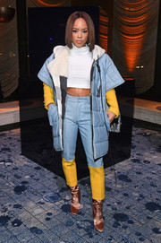 Serayah McNeill was sporty in a blue puffer coat layered over a white crop-top at the Stuart Weitzman presentation.
