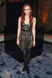 Madeline Brewer contrasted her girly frock with edgy black ankle boots by Stuart Weitzman.