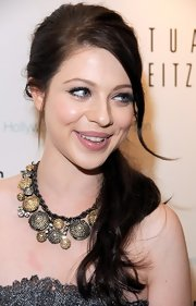 Michelle Trachtenberg wore a low ponytail to the Stuart Weitzman Young Hollywood Cares Collection unveiling. Creating this casual style involves sectioning out a few face-framing strands, backcombing the crown and then smoothing hair into a ponytail at the nape of the neck.