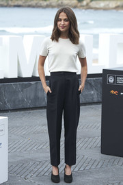 Alicia Vikander went low-key in a plain white knit top at the San Sebastian Film Festival photocall for 'Submergence.'