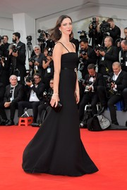 Rebecca Hall matched a black box clutch with a spaghetti-strap gown for the Venice Film Festival premiere of 'Suburbicon.'