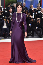 Alessandra Mastronardi's long-sleeve purple Alberta Ferretti Couture gown at the Venice Film Festival premiere of 'Suburbicon' looked oh-so-elegant in its simplicity!